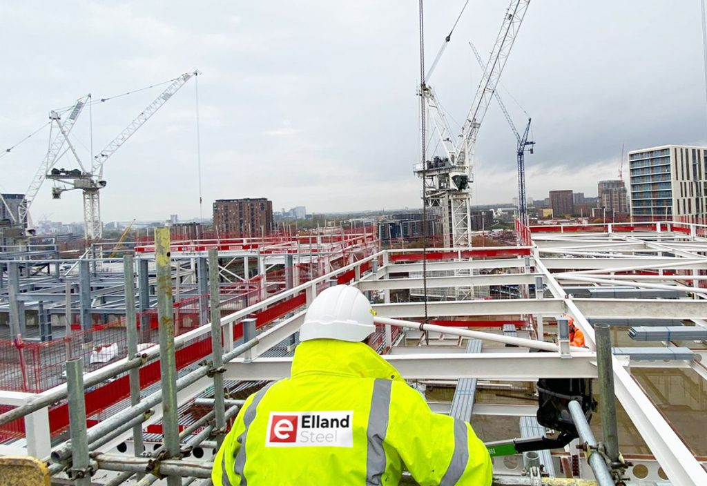 MGY site manager overlooking steel frame