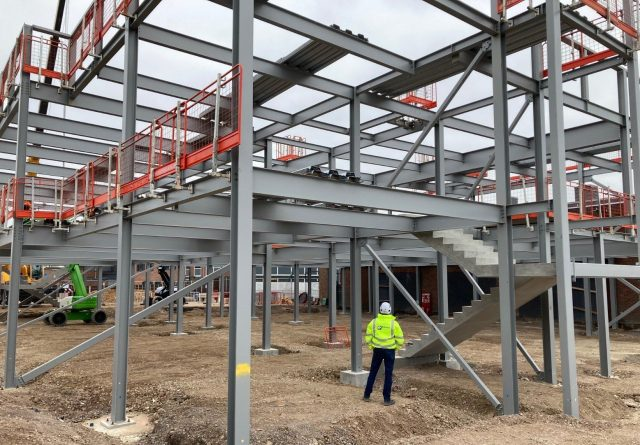 Elland Steel contracts manager inspecting steel frame at Chiltern Hills Academy