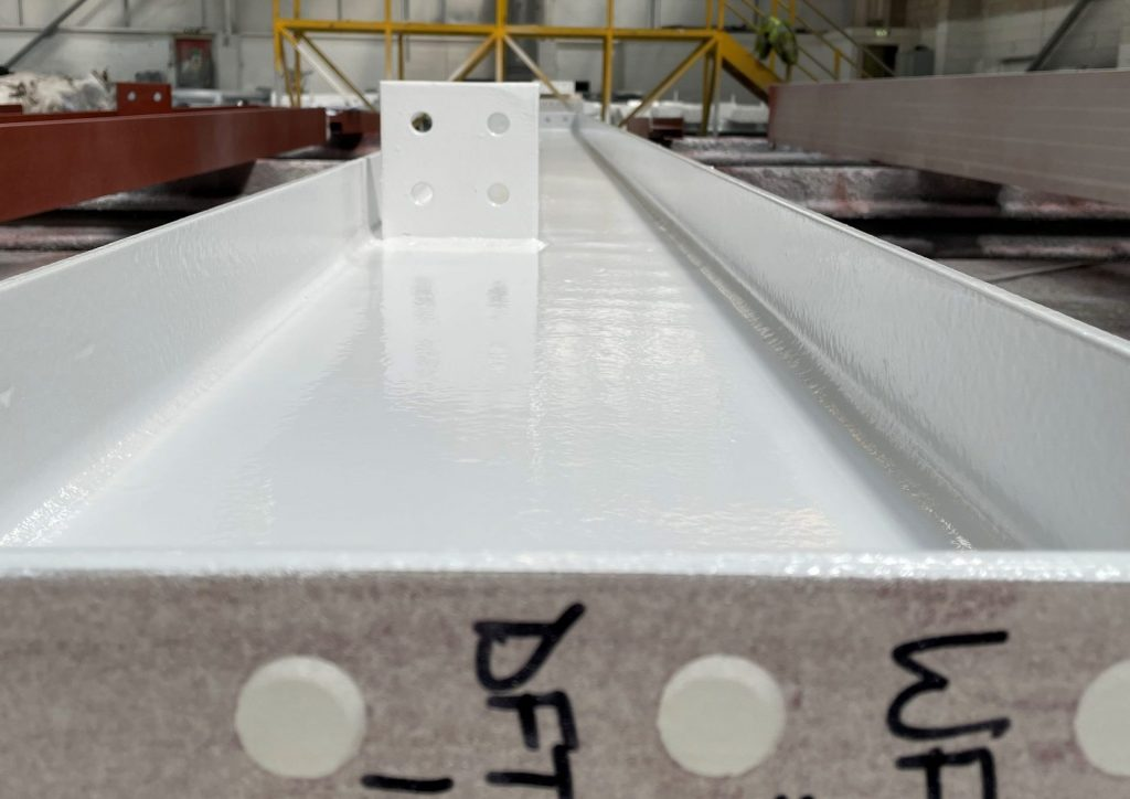 Steel beam with in-house shop applied Intumescent coating