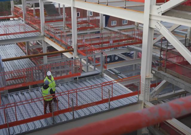 Elland Steel team discussing University of Salford SEE building